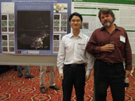 Tan Kun and Chris Small standing in front of the poster they presented at  the Fifth Annual Workshop on the Analysis of Multi-temporal Remote Sensing Images, Mystic, Connecticut, July 28.