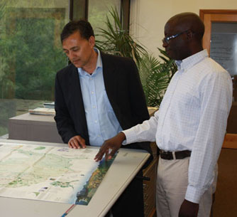 Chandra Giri and Malanding Jaiteh examine a map from the mangroves data set, which they collaborated on.