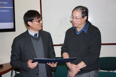 Min Liu, dean of School of Geographic Sciences at East China Normal University in Shanghai, with Robert Chen, CIESIN director