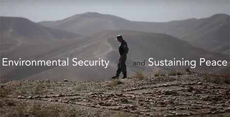 Photo of soldier with mountains in background and title of massive open online course, Envirmental Security and Sustaining Peace