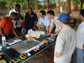 photo showing meeting betwee Haiti Regeneration Initiatiative Project Partners and local people using topographical model to demonstrate project objectives
